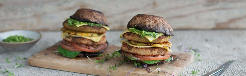 Braaied Mushroom and Fry's Chicken Burger with Basil, Rocket Pesto and Pineapple.